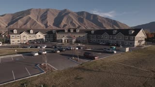 An Aerial Dolly Shot Of Retirement Home By The Mountains In City