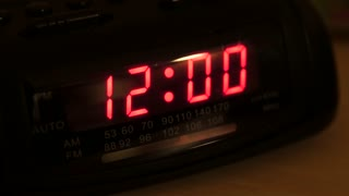 An alarm clock that has been reset from power loss