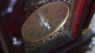 Antique clock hands turn with time