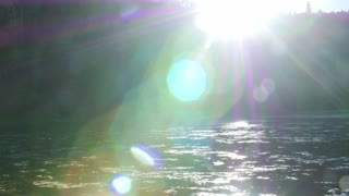 Beautiful mountain lake with tons of flies, bugs and sun flare