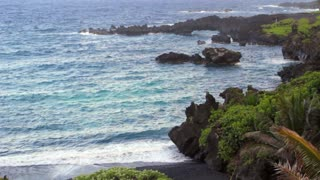 Black Sand Beach and Sea Arch