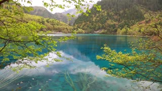 blue water lake in jiuzhaigou valley national park in china dolly shot
