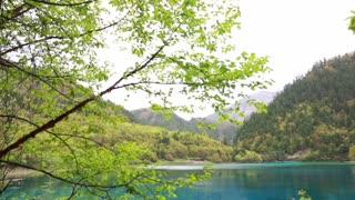 blue water lake in jiuzhaigou valley national park in china tilting shot