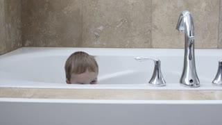Boy playing in the bath tub
