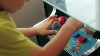 boy playing with old arcade
