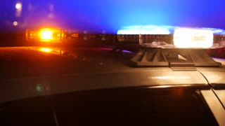 Bright police lights at accident at night