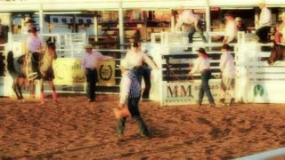 Bucking Horse Rams Into Gate at Rodeo