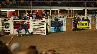 bull rider at rodeo slow motion