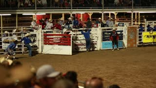 bull rider in rodeo slow motion