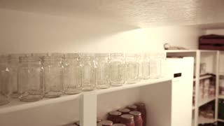 canned food in jars in storage room