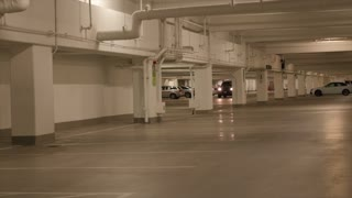 Car driving in parking garage