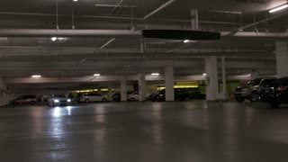 Car driving in underground parking garage