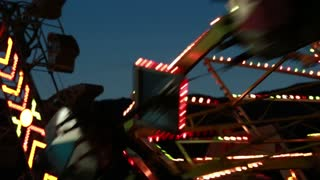 carnival ride at night time with flashing lights