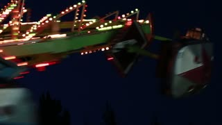 carnival ride at night with flashing lights