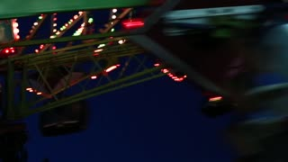 carnival ride at night with lights
