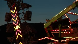 carnival rides at night time with flashing lights