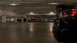 Cars driving in underground parking garage