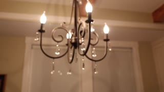 chandelier in the home dolly shot