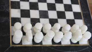 Chess pieces on the stone chess board