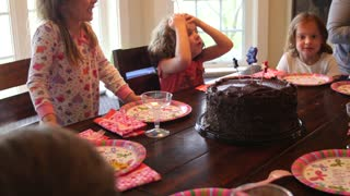 Children at birthday party with cake