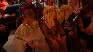 Children at christmas party dressed for nativity
