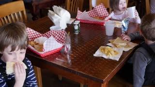 Children eating a cheese quesadilla at restaurant