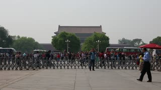 chinese tourists entering the gates to the forbidden city