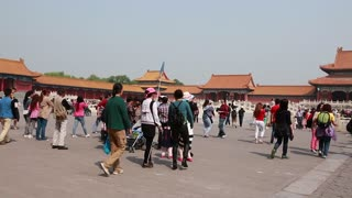 chinese tourists inside the gates of the forbidden city beijing china