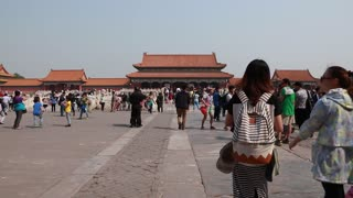chinese tourists inside the gates of the forbidden city