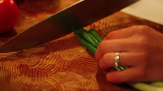 chopping green onion for spinach salad