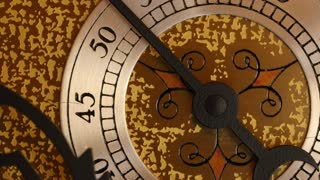 Closeup dolly shot of the second hand on a grandfather clock