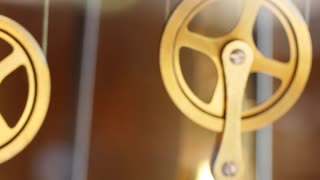 Closeup slow dolly shot of pendulum on grandfather clock