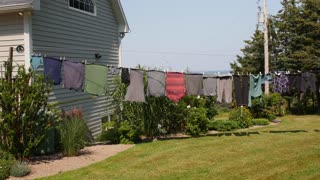 Clothes drying on a line blowing in a wind