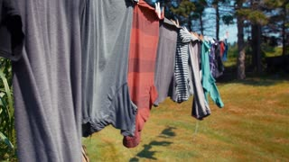 Clothes hanging on a line blowing in wind