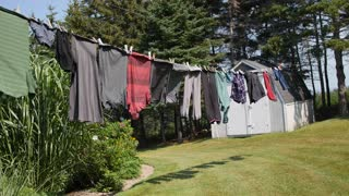 Clothes hanging on line blowing in wind