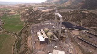 Cool high aerial shot of large coal power plant
