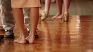 Couples dance at a wedding reception to music