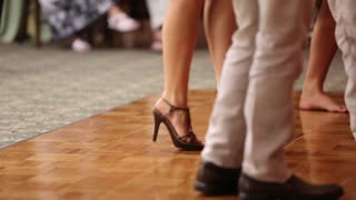 Couples dancing at a wedding reception to music