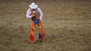 Cowboy limping at rodeo slow motion