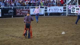 Cowboy Picking Up Hat at Rodeo Slow Motion