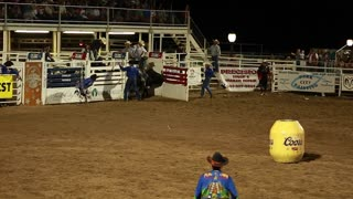 cowboy riding a bull at rodeo slow motion