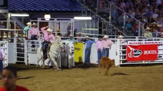Cowboy Ropes a Calf at Rodeo Slow Motion