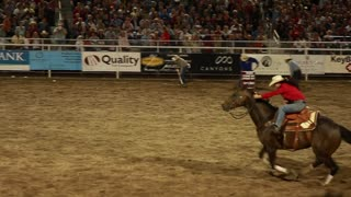 cowgirl barrel racing at rodeo slow motion