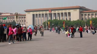 crowds standing in tiananmen square in beijing china