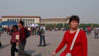 crowds walking at tiananmen square china