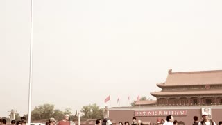 crowds walking in tiananmen square in beijing china