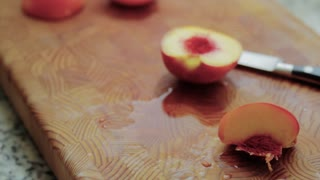 cutting tasty peaches for food storage