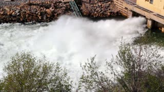 Dam opens sluice gates for flood waters