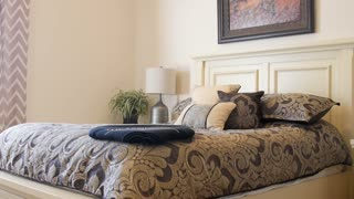 Dolly Shot Of A Beautiful Large Bed With Pillows