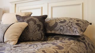 Dolly Shot Of Beautiful Large Bed With Pillows